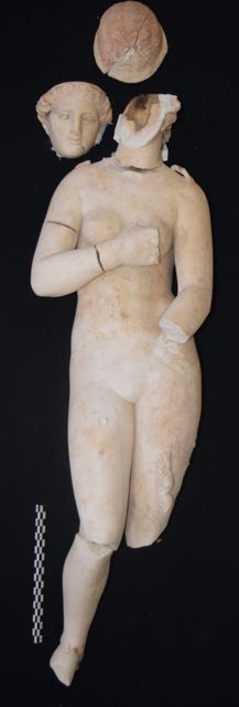 Marble statue of Aphrodite, the Graeco-Roman goddess of love, recovered at Petra in Jordan. A small Cupid on the lower right gazes up at Aphrodite. A handheld glass vial in visible on her left leg, probably from another figure now lost. The statue, about half life-size, probably dates to the second century A.D. Photo courtesy of Tom Parker.