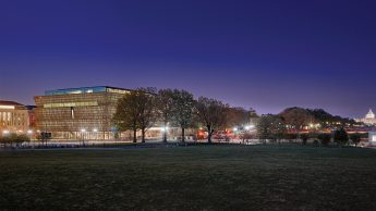 The Smithsonian National Museum of African American History and Culture at night.