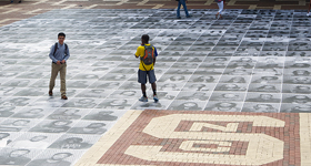 Students stand in the Brickyard