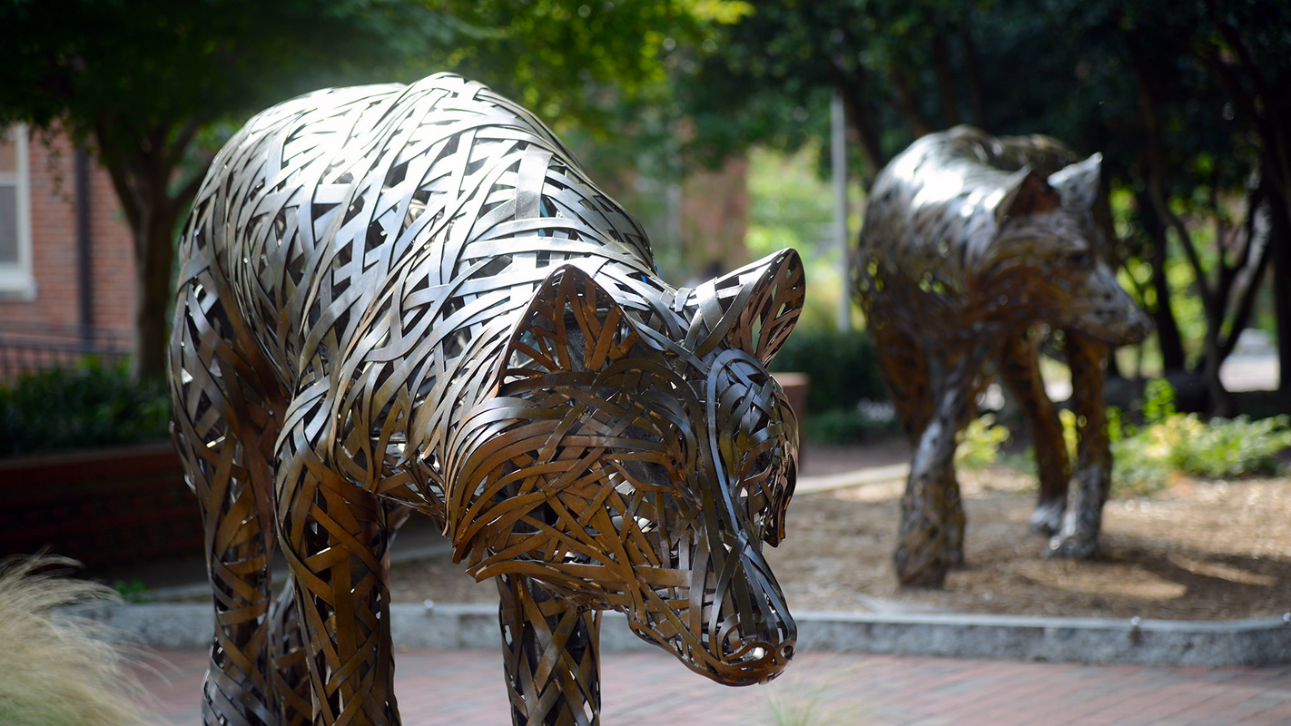 Two of the copper wolves at Wolf Plaza on NC State's campus.