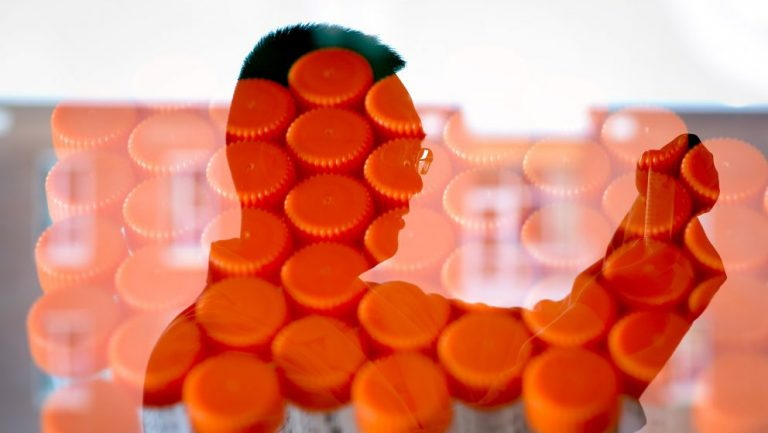 Orange test tubes superimposed over the profile of NC State researcher Zhen Gu.