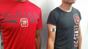 Red and grey NC State T-shirts featuring thermoelectric generators.