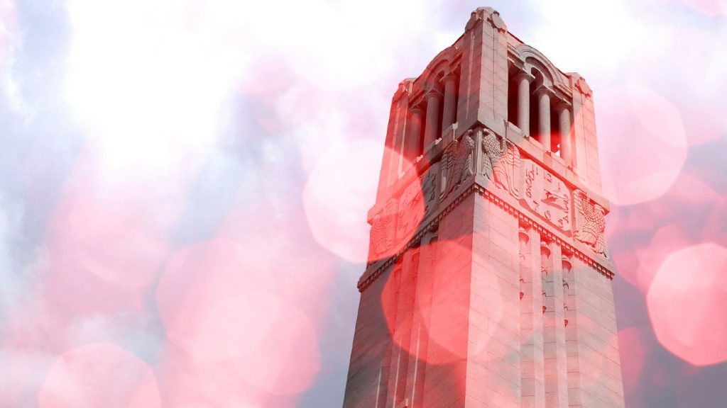 A stylized, rose-tinted NC State Memorial Bell Tower.