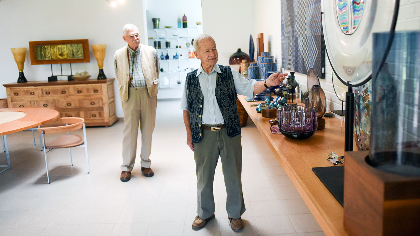 Two older gentlemen giving a tour o