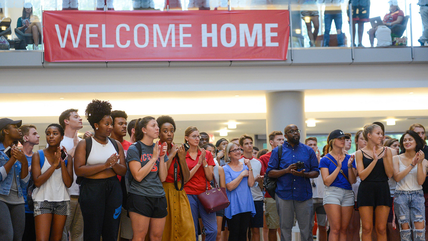 "Students gathered under a ""Welcome Home"" banner at Respect the Pack 2016."