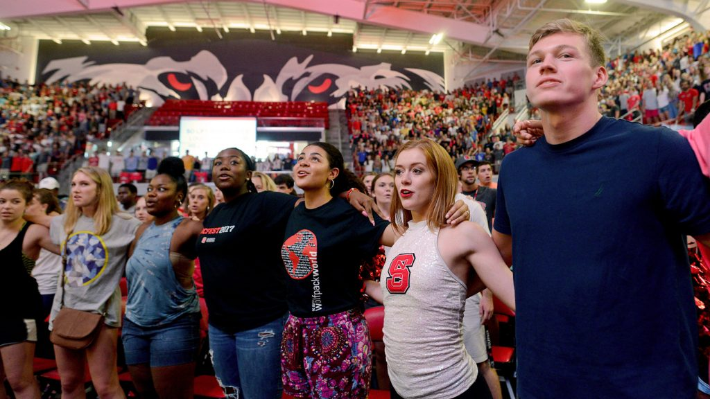 A group shot of students in Reynolds Coliseum during NC State's 2017 convocation.