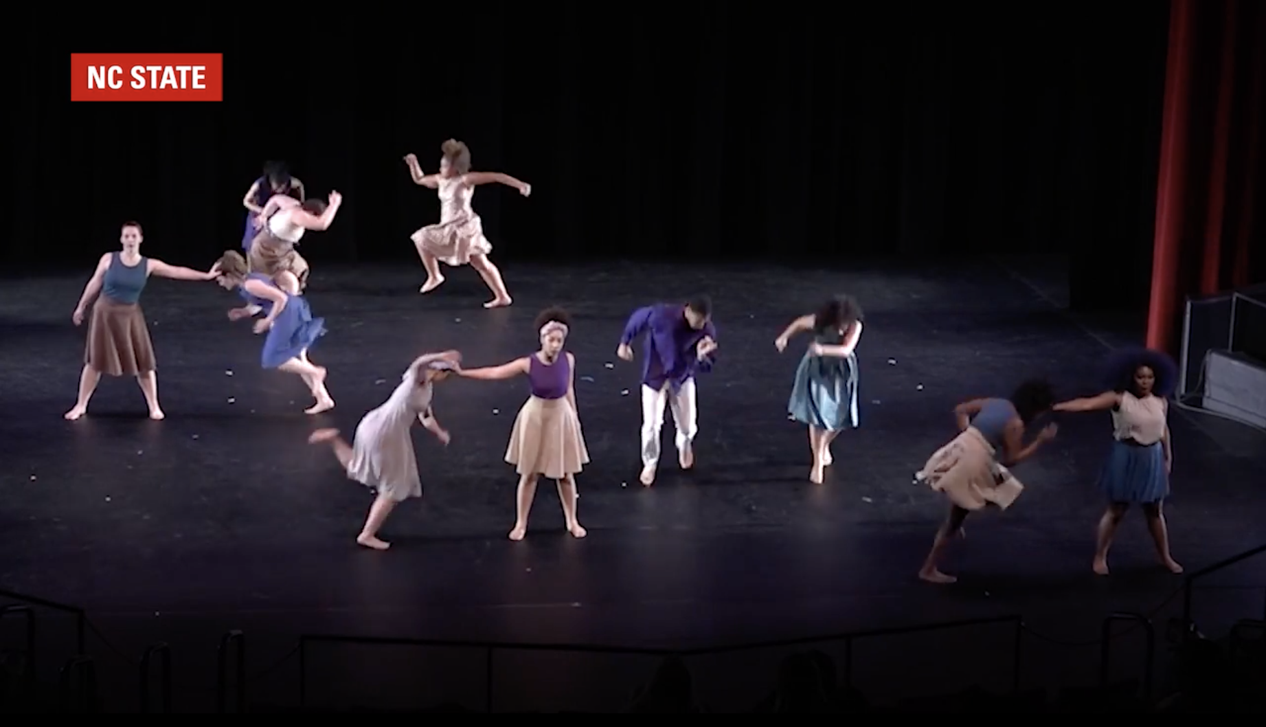 Students with the NC State Dance Program perform on stage.