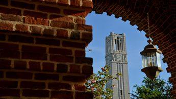 Spring morning sun illuminates the Holladay Hall and the Memorial Belltower.