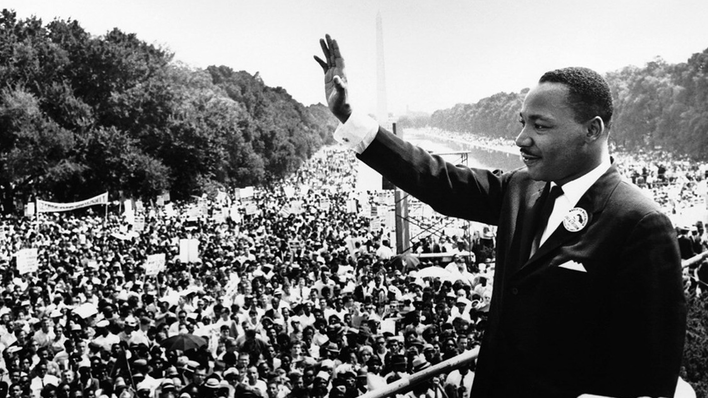 Martin Luther King Jr. greets the assembled crowd at the March on Washington in 1963.
