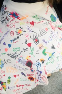 A close-up of Kaitlin Montgomery's skirt, hand-decorated by her students.