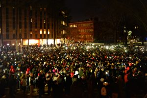 Students congregate for a candlelight vigil for three slain NC State students