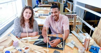 Emily Doyle and Cameron Westbrook prepare airport design