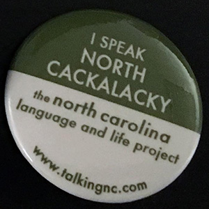 Pin that says I Speak North Cackalacky
