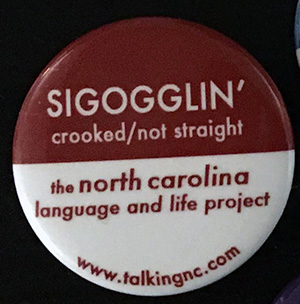Pin that says Sigogglin'