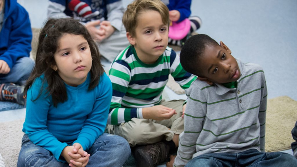Three children in a classroom.