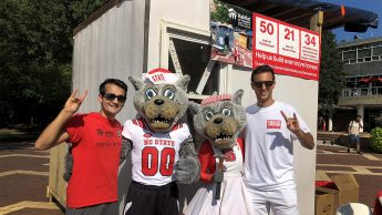 NC State students posing with Mr. and Mrs. Wuf