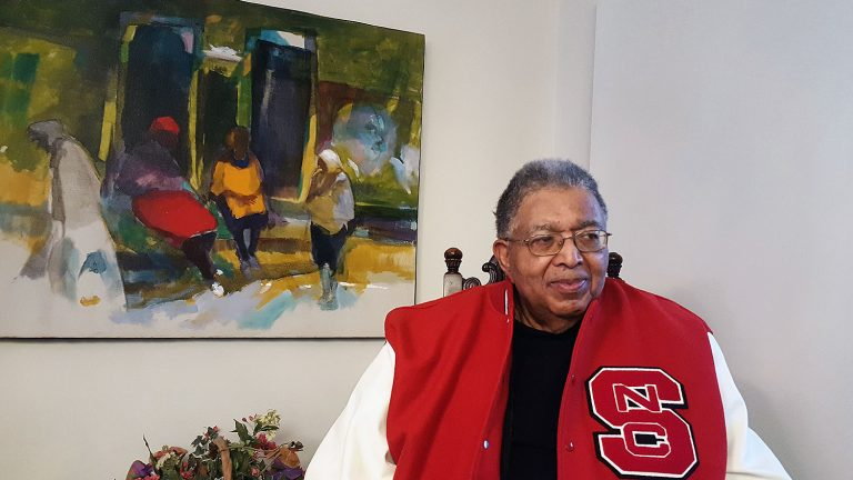 Recent photo of Irwin Holmes in his letterman's jacket.