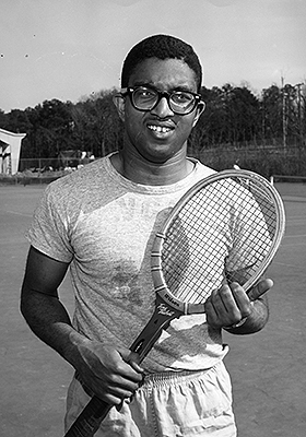 Holmes on tennis court in the 1950s.