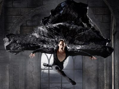 A dancer dressed as Dracula leaps into the air.