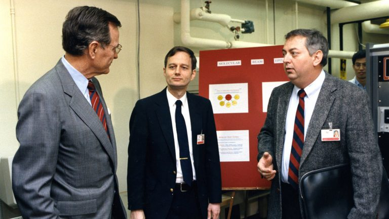 President George H.W. Bush talks with two NC State faculty during a visit to campus in 1990