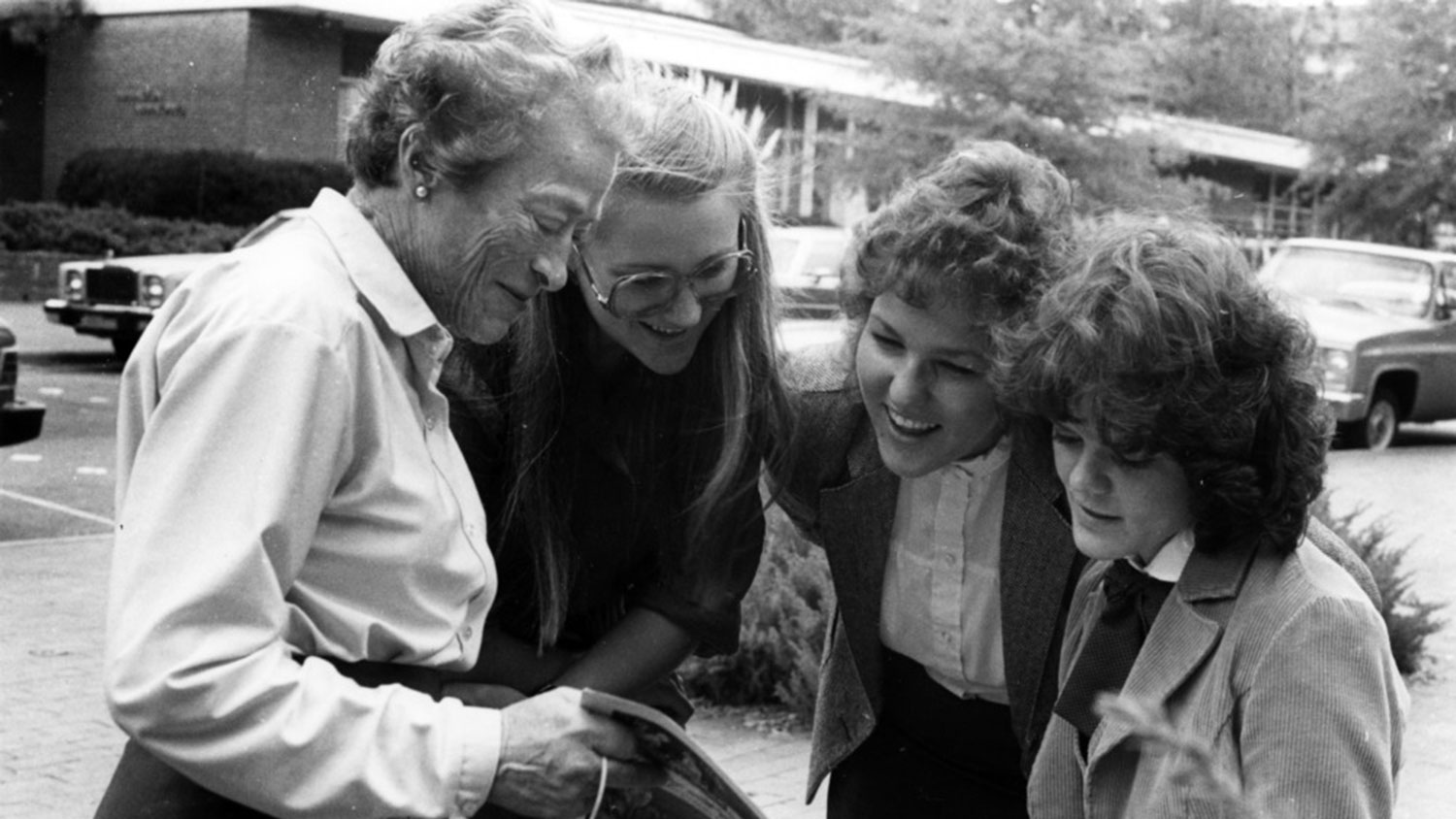Katherine Stinson, the first female graduate of the College of Engineering, with students on campus (circa 1970s).