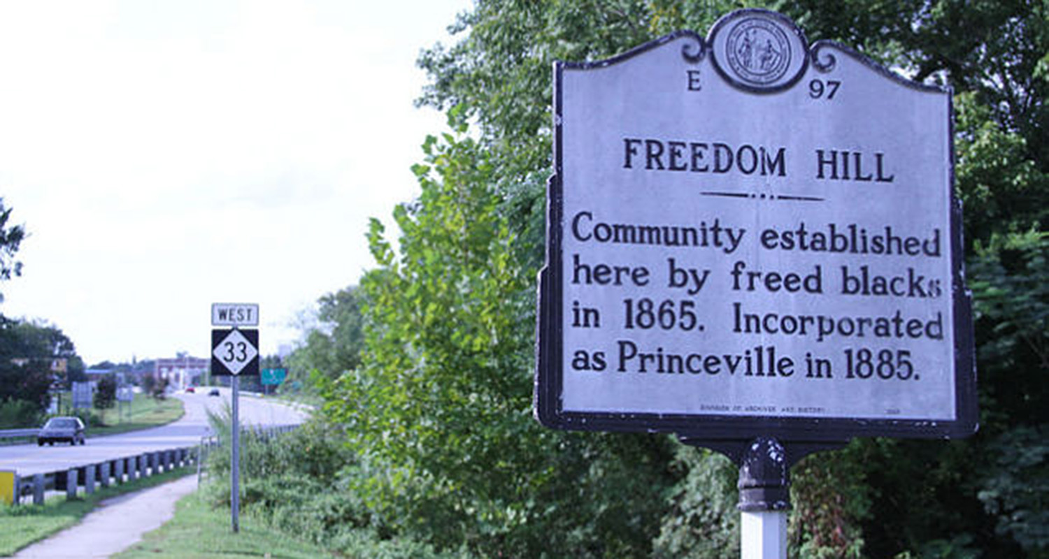 Historic marker noting the founding of Princeville as Liberty Hill in 1865.