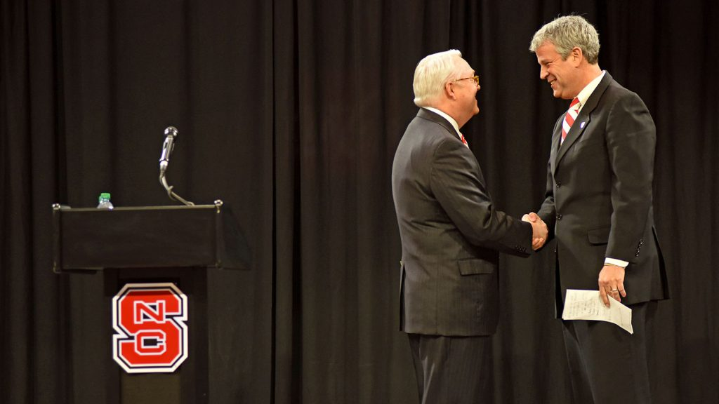 Chancellor Randy Woodson greets Boo Corrigan at Reynolds Coliseum Thursday.