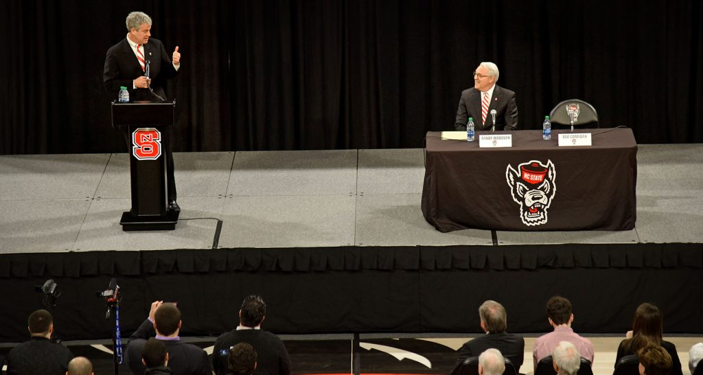 Boo Corrigan and Chancellor Woodson share the stage at Reynolds Coliseum.