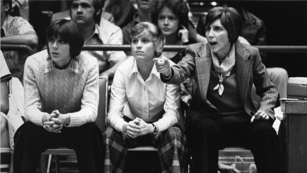 Kay Yow coaches from the bench at an NC State women's basketball game.