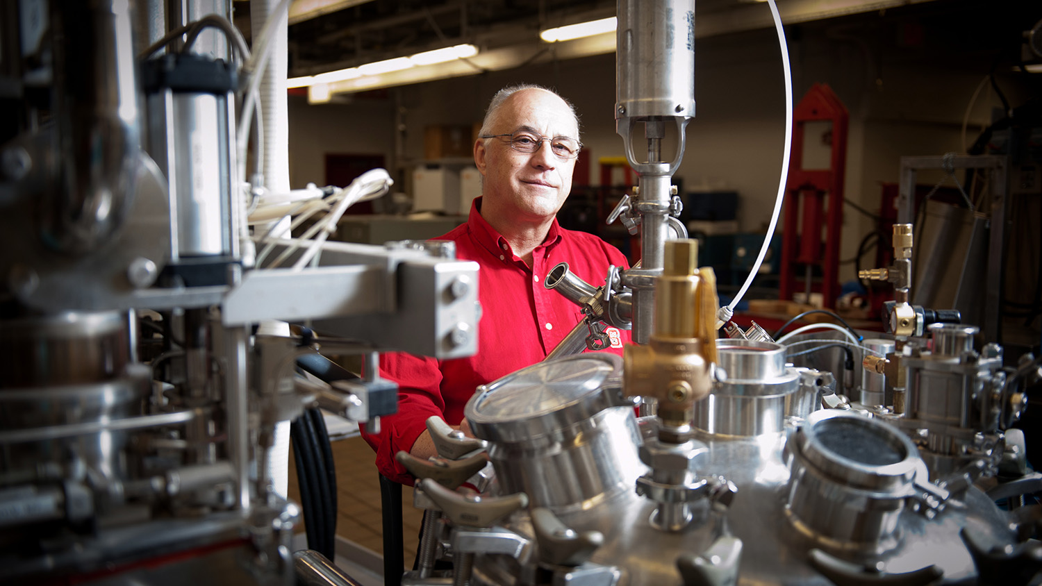 Josip Simunovic in his lab, surrounded by shiny, metal equipment.