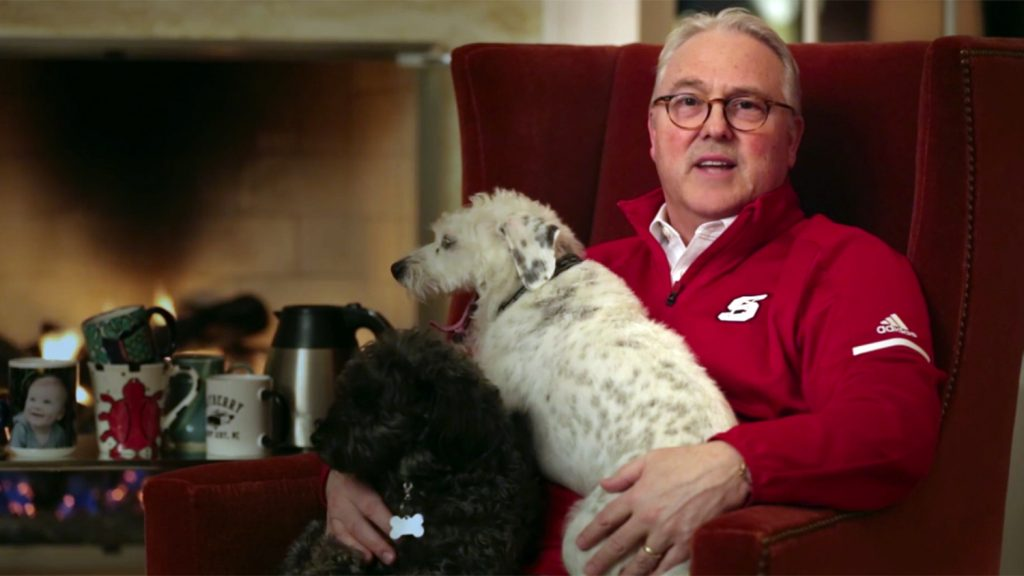 Randy Woodson in easy chair with dogs.