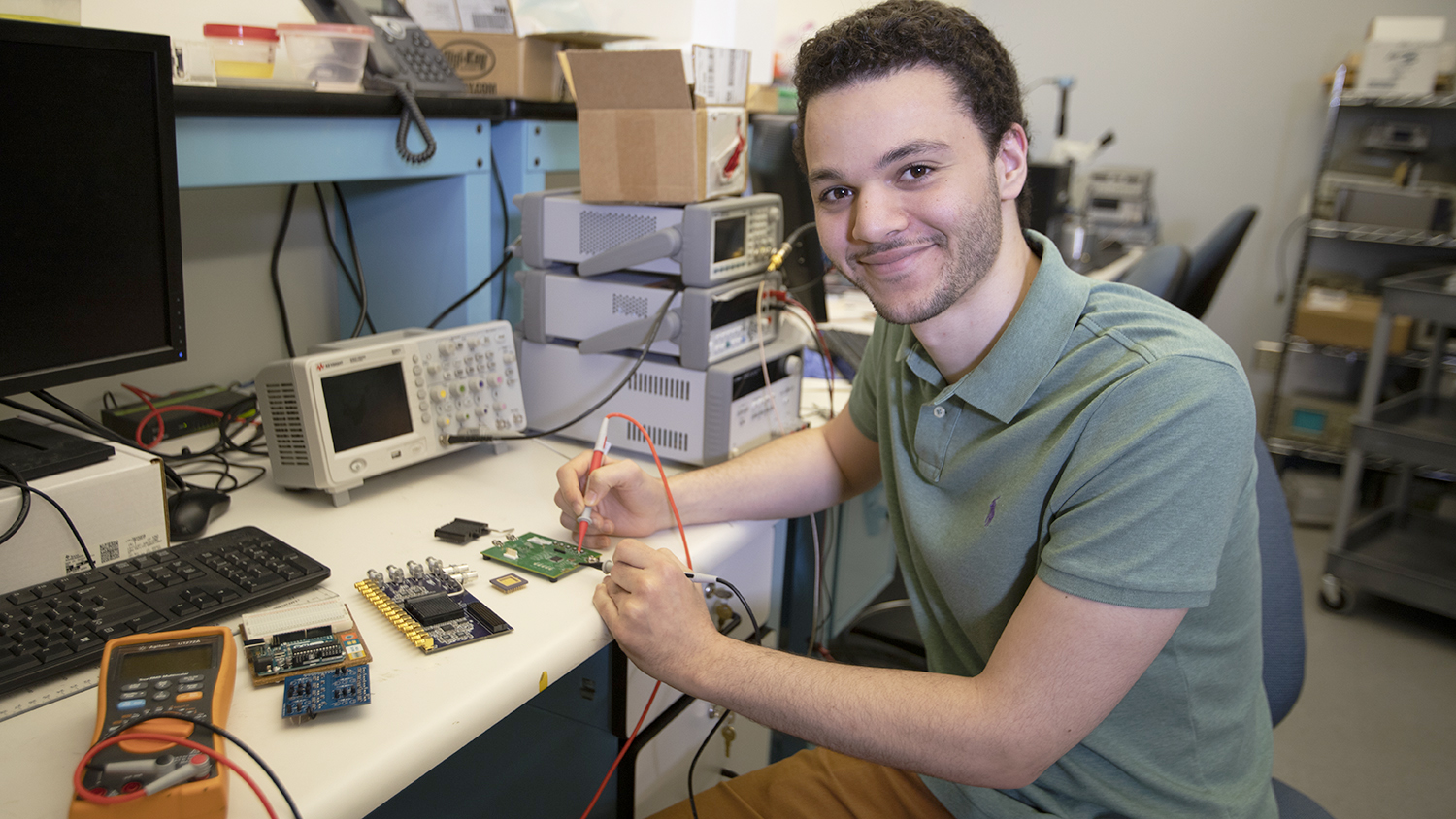 Ziad Ali works on a circuit in his lab.
