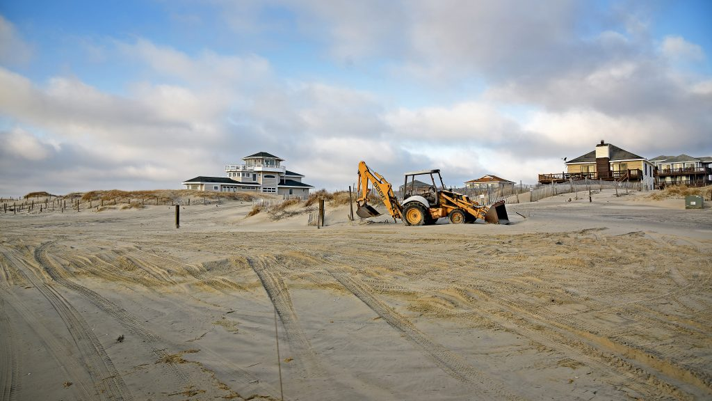 Heavy equipment on the beach to move sand
