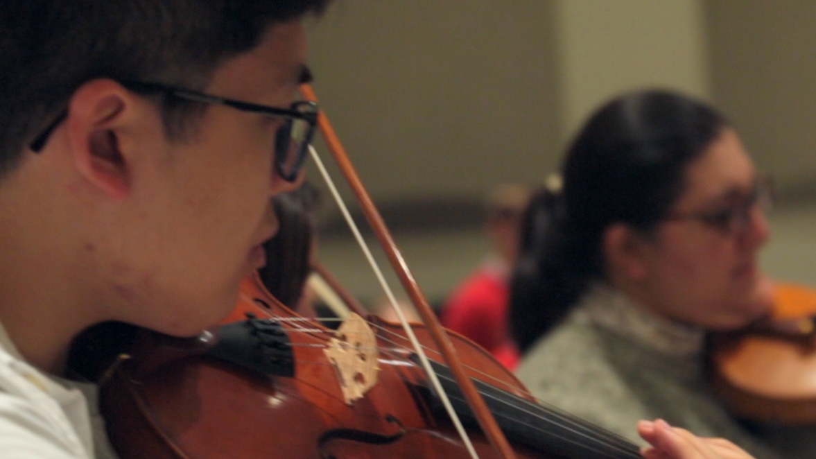 Violinists performing in the Raleigh Civic Symphony
