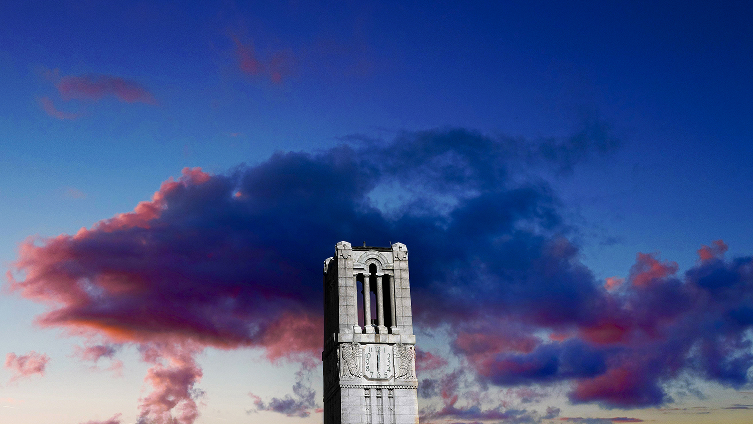 The Belltower against colorful clouds at sunset.