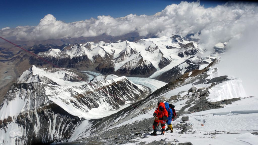 Two climbers on the snowy slopes of Mount Everest.