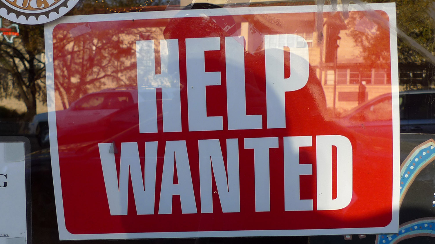 help wanted sign in a window