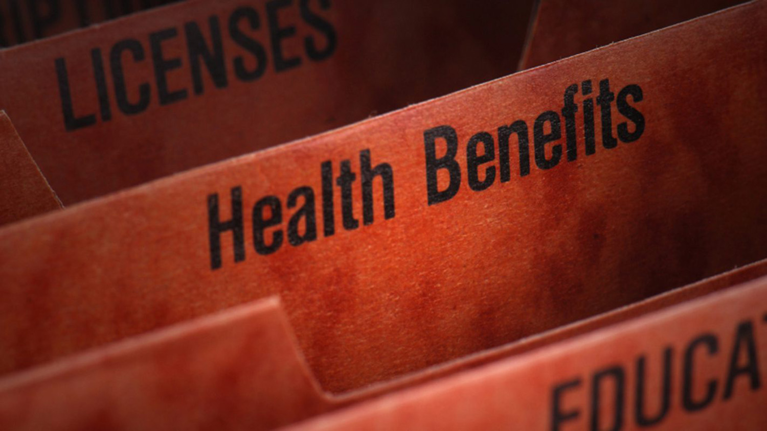 File folder with the words health benefits on the tab.
