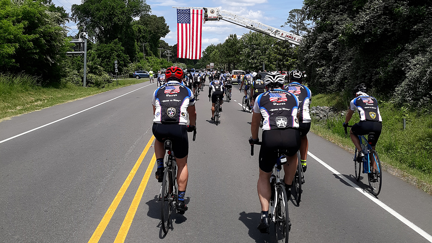 Cyclists from Raleigh approach Jamestown, Virginia.