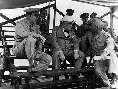 Gen. Bill Lee, right, talks with British Prime Minister Winston Churchill while Gen. George C. Marshall looks on. U.S. Army photo.
