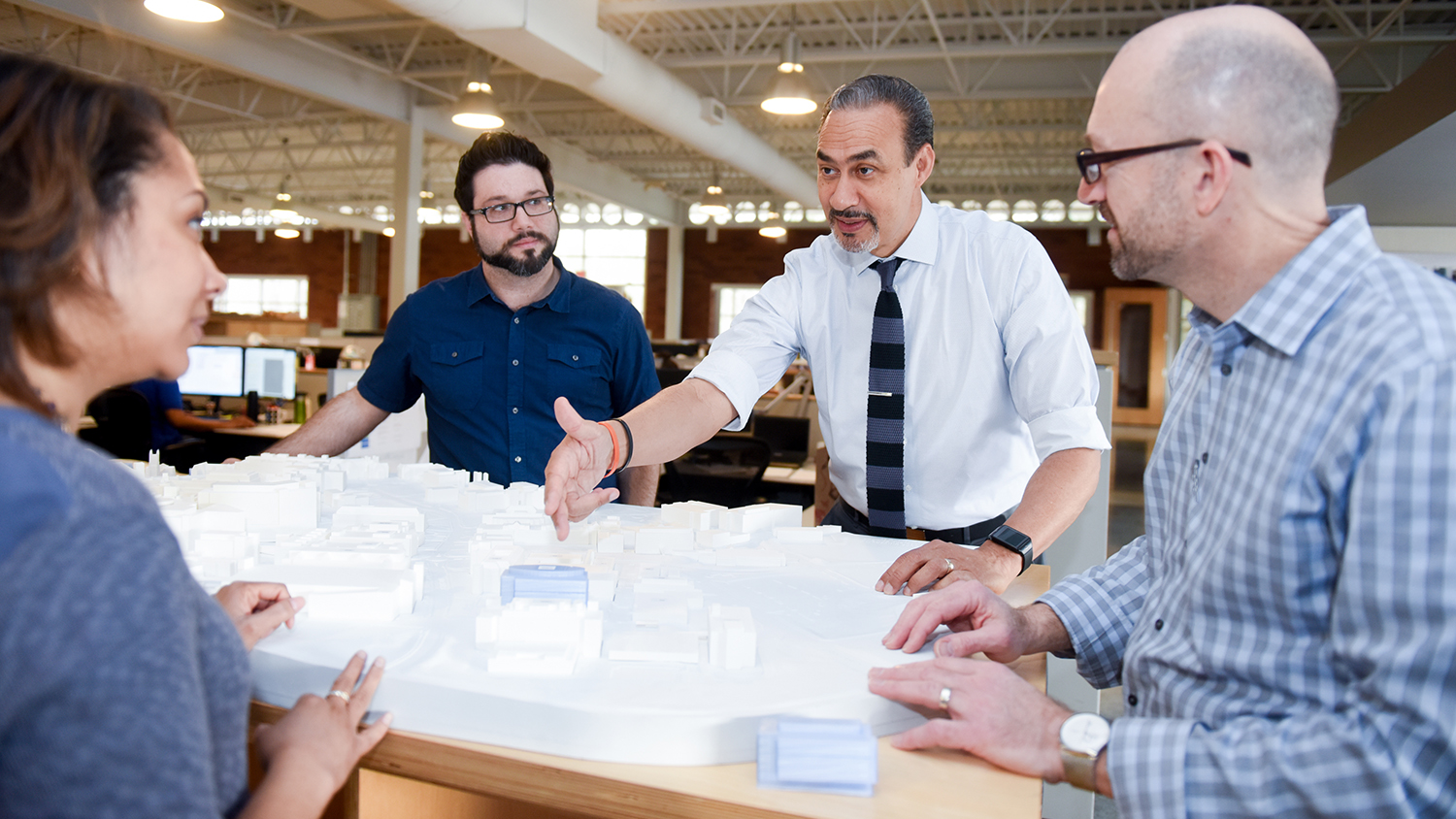 Phil Freelon with scale model of an architectural project.