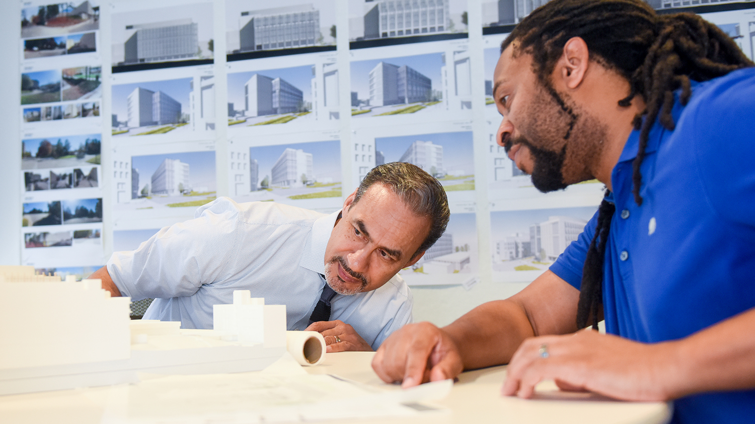 Phil Freelon examines a project in his durham office.