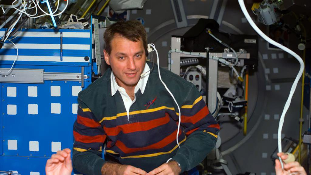 Richard Linnehan, NASA's first-ever veterinary astronaut, floating in space.