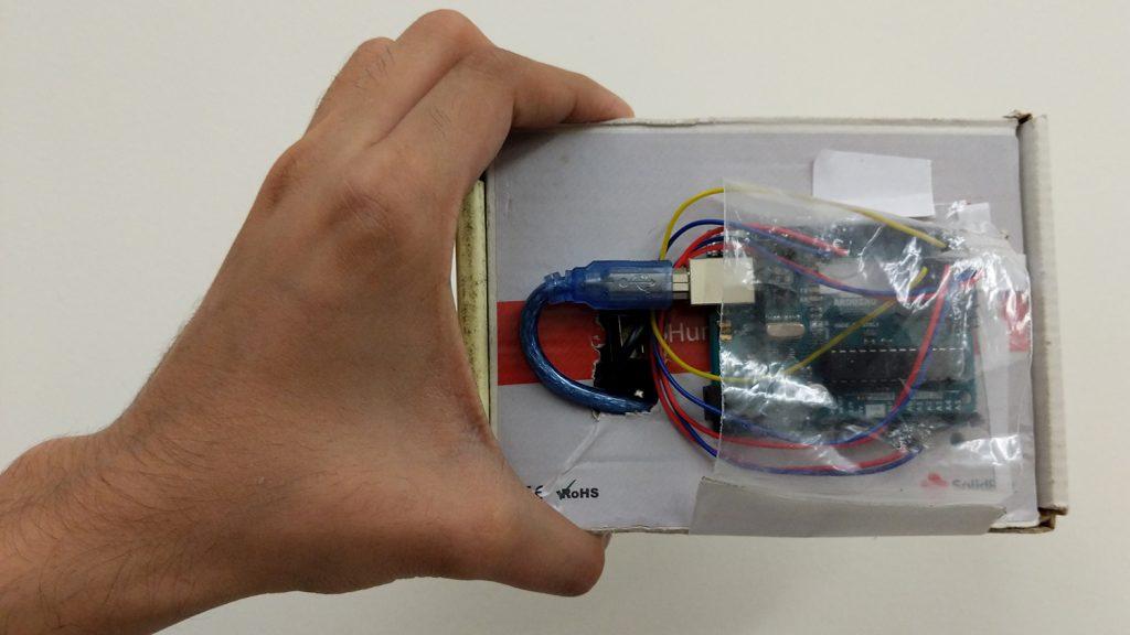 hand holding wio prototype