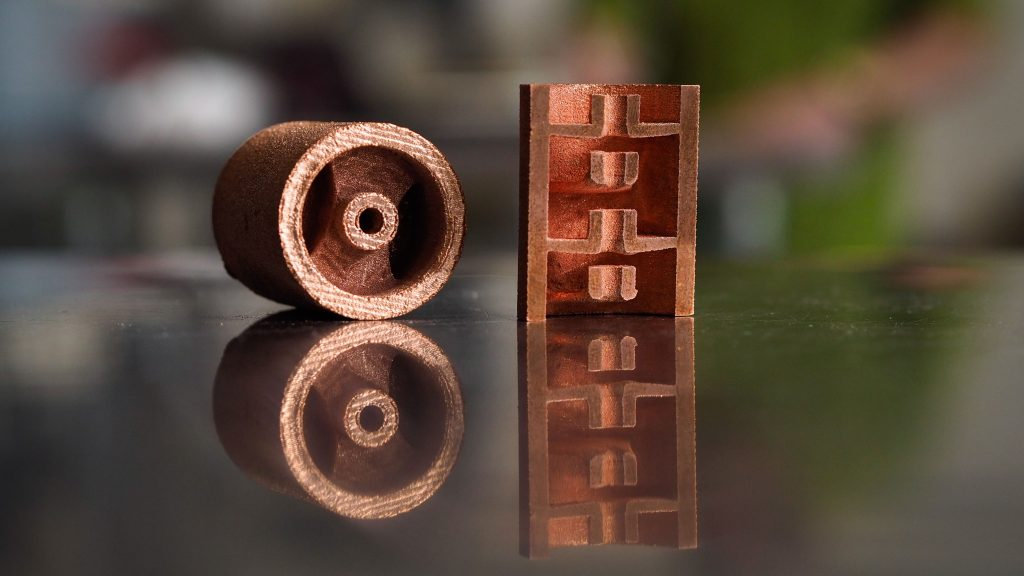 Copper vacuum tubes printed in NC State's Center for Additive Manufacturing and Logistics.