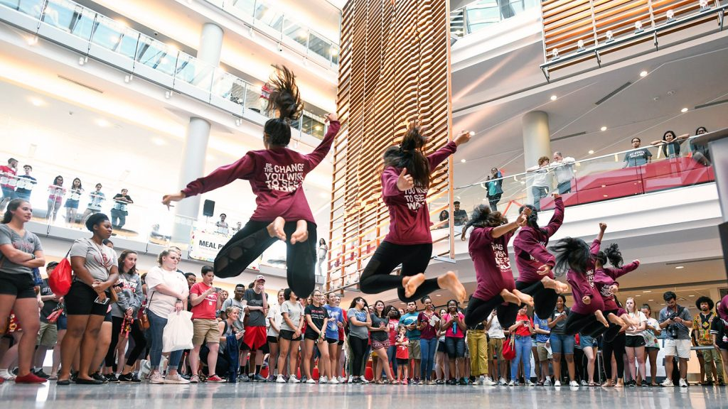 Students dance for a crowd as part of Wolfpack Welcome Week in Talley Student Union.