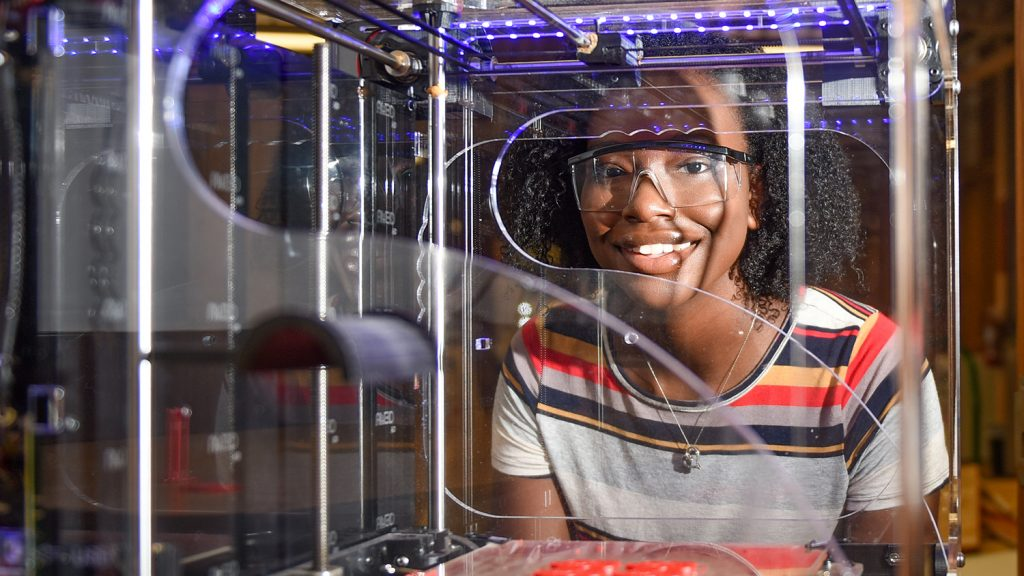NC State student Niambé James using a 3D printer at the College of Natural Resources.