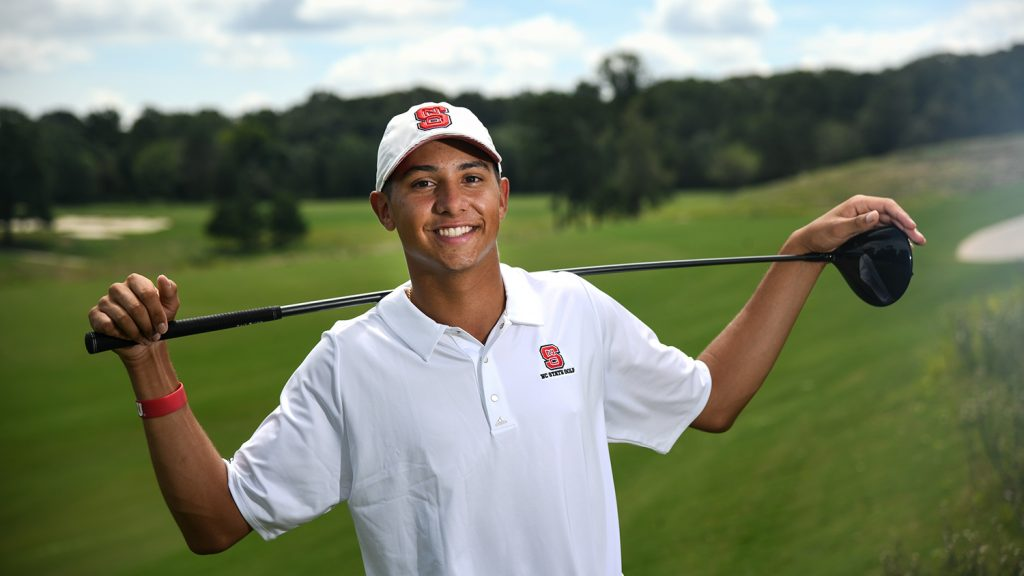 Incoming student Spencer Oxendine stands on the golf course with his club.