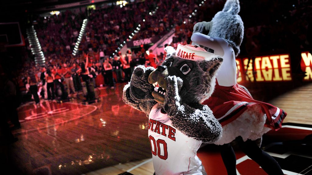 Mr. and Ms. Wuf howling at an NC State men's basketball game