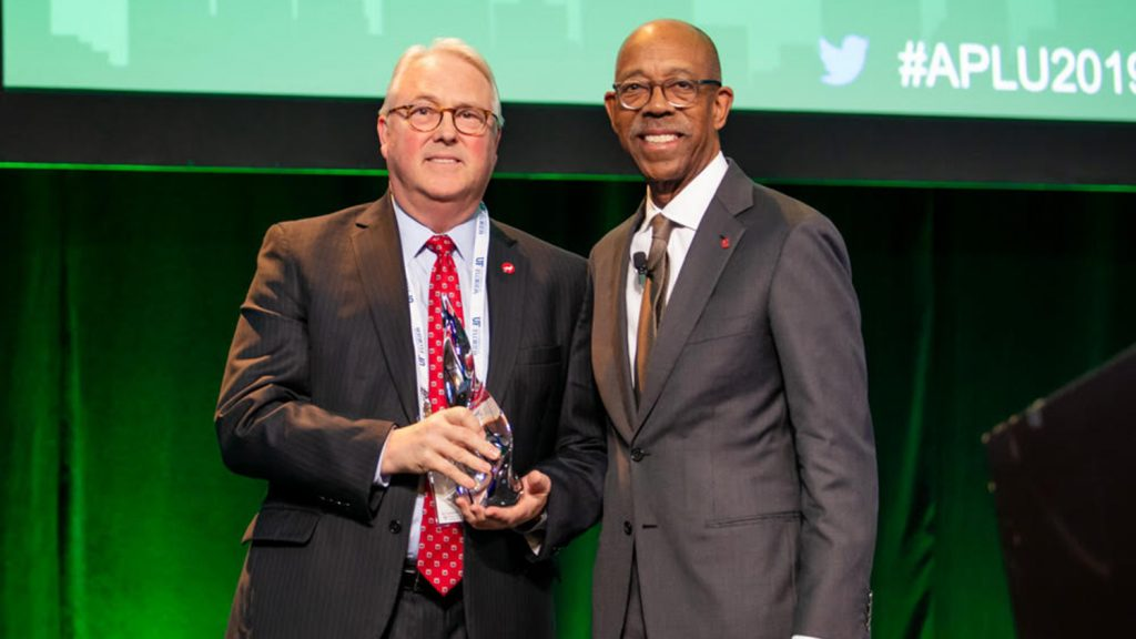 photo of Chancellor Woodson receiving award.